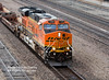BNSF 7399(ES44DC) bringing a load of empty well cars SW through KC Union Station
