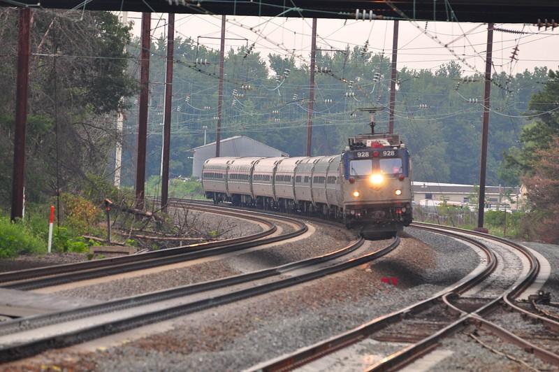 AEM-7 # 928 leads a regional train southbound through Odenton.