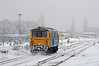 73109 sets off en-route to Brighton, the Horsham line in the foreground is completely snow covered.