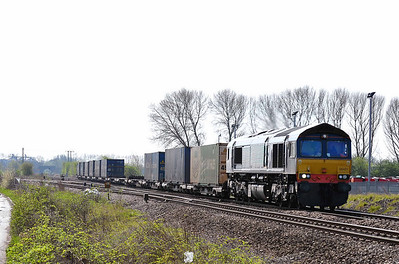 Class 66 No 66421 at Sherburn Junction on 9 April 2011 with the diverted 4S49 07:10 Daventry - Grangemouth Intermodal (running 8 min early)