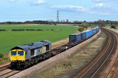 Class 66 No 66304 at Burton Salmon on 2 April 2011 with the 4M16 04:58 Grangemouth - Daventry (running 71 min late)