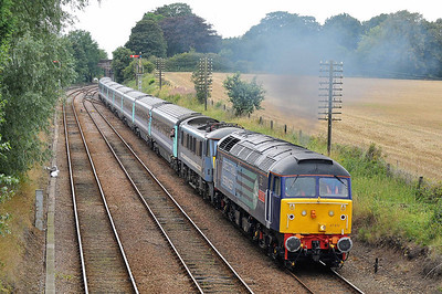 Class 47 No 47810/90002 at Reedham on 6 August 2011 with the 1V18 Liverpool Street  - Great Yarmouth (running 6 min late)