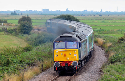 Class 47 No 47810 near Tunstall on 6 August 2011 with the 1V33 10:40 Great Yarmouth - Liverpool Street (running 1 min late)