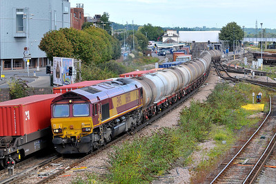 Class 66 No 66058 at Eastleigh on 9 August 2011 with the 6V62 09:18 Fawley Oil Refinery - St Phillips Marsh (running on time)