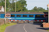 …which flashes across the level crossing past Prees box.