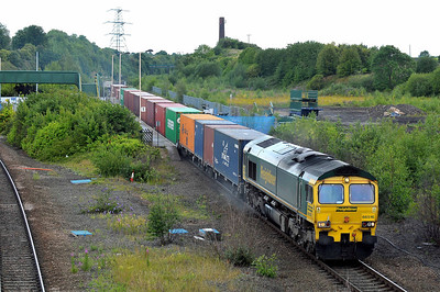 Class 66 No 66516 at Normanton on 8 July 2011 with the 4E24 10:39 Grain - Leeds FLT (running 3 min early)