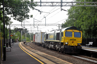 Class 66 No 66593 at Long Buckley on 11 July 2011 with the 4L68 12:15 Birch Coppice - Felixstowe (running 75 min early)