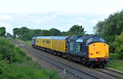 Class 37 No 37603 at Lynwith Lane Crossing - Carlton on 23 June 2011 with the 2Q88 06:05 Doncaster West Yard - Doncaster West Yard (via Drax Power Station) (running 7 min early)