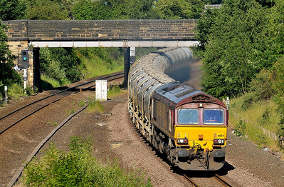 Class 66 No 66154 in Horbury Cutting on 4 June 2011 with the 6F70 05:36 Clitheroe - Toton Yard (running 10 min early)