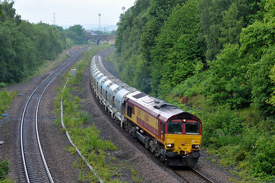 Class 66 No 66144 in Horbury Cutting on 25 June 2011 with the 6F70 05:36 Clitheroe - Toton North Yard