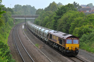 Class 66 No 66095 in Horbury Cutting on 28 May 2011 with the 6F70 05:36 Clitheroe - Toton North Yard (running 14 min early)