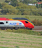 390 054 wearing this Alstom logo instead of the more usual Virgin branding.