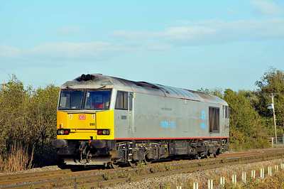 Class 60 No 60099 at Heck Ings on 3 October 2011 with the 0D13 16:24 Knottingley TMD - Drax Power Station (running 8 min early)