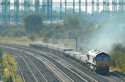 Class 66 No 66112 at Washwood Heath on 28 September 2011 with the 6G22 15:55 Washwood Heath CMX - Bescot ES (running 1 min early)