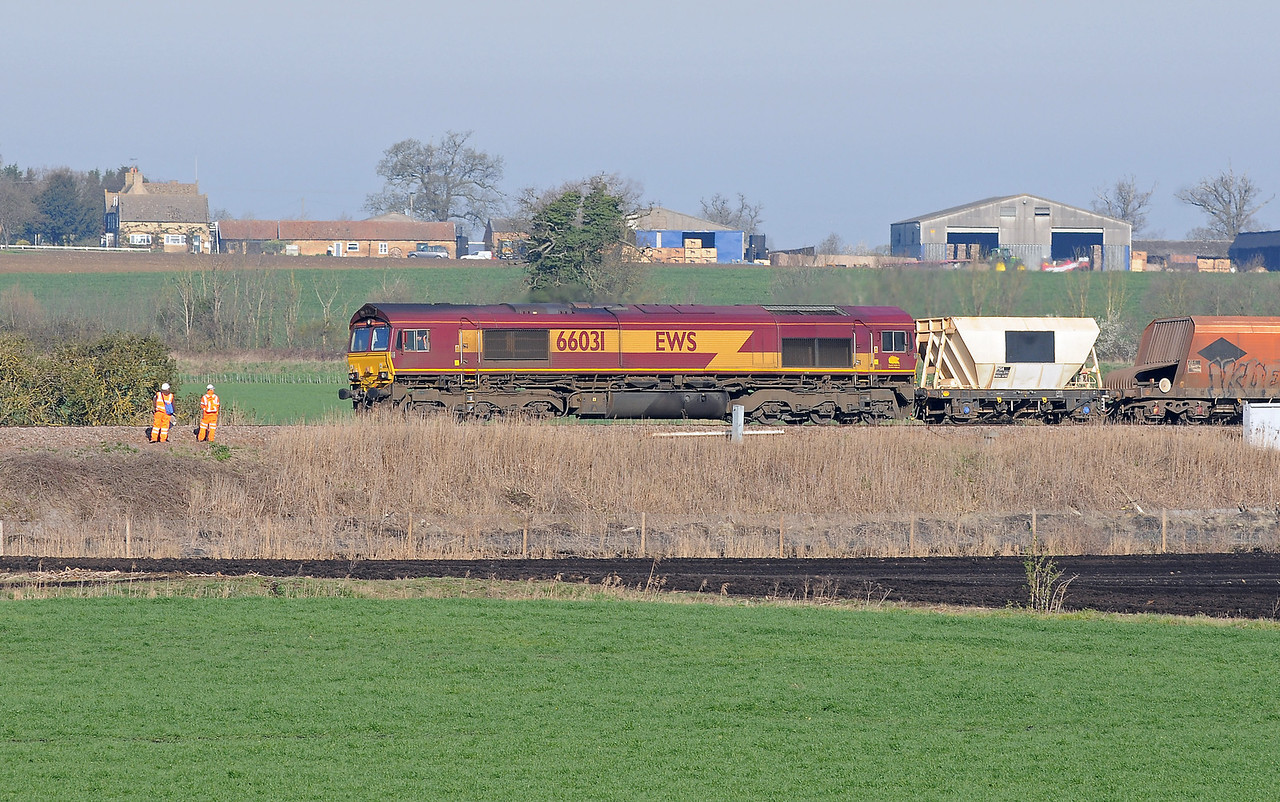 ...whilst the former was 66031 on a rake of mixed four wheel and bogie hoppers on what I think may have been the 6L41 Mountsorrel to Barham passing a gang of Network Rail staff. 66031 had certainly been reported at Mountsorrel on an FMi listing earlier in the day.