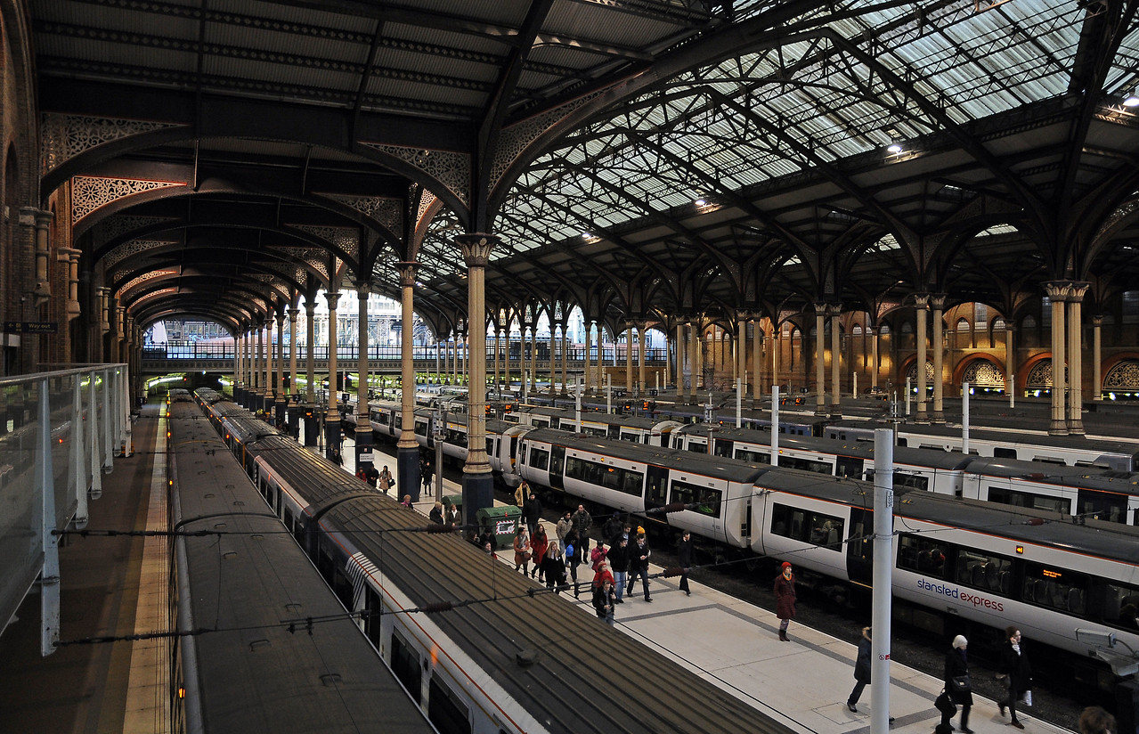 When Liverpool Street was rebuilt in the late 1980s the south train shed was removed and the air rights above the station sold, but the north trainshed, which is older is preserved, here playing host to a variety of NXEA EMUs.