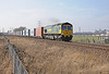 66541 is passing Stanground Wash on the 4L85 Doncaster to Felixstowe train, formed almost entirely of 45 foot boxes, with just a handful of 1TEU boxes on the rear couple of flats. That's Peterborough's Norman cathedral on the right.