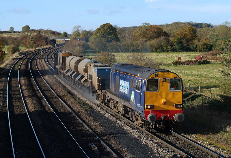 A clean 20312 passes Barnetby in charge of 3S13 Wrenthorpe- Grimsby rhtt.02/11/2012.Fuji s3 pro.