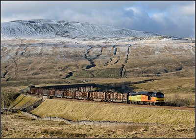 2018 02 02.60096 on the 12.58 Carlisle - Chirk Kronospan the loaded timber at Ribblehead.