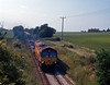 Near High Halstow on the Isle of Grain an early EWS intermodal service, the 4Z59 04:36 Ditton to Thamesport.