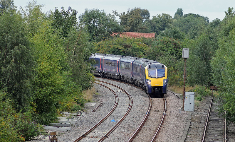 Spalding was once an important junction, with the GN's secondary mainline from Peterborough to Grimsby via Boston crossed by the GN &GE Joint. Today only the mainline from Peterborough and the Joint Line to Lincoln and Doncaster remain. The Joint Line SE to March is no more neither is the East Lincs mainline to Boston. Coming off the Joint Line is Hull Trains 180 110 on the 1A94 13:03 Hull to Finsbury Park. The overgrown siding on the right is all that remains of the East Lincs Mainline. Most of the latter between Spalding and Boston is now the A16.