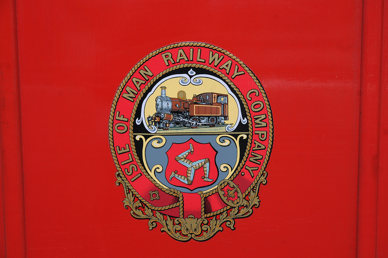 The crest of the Isle of Man Railway with the three legged symbol of the island - Tree Cassyn Vannin in Manx Gaelic - and a Beyer Peacock 2-4-0T. The latter is something of an island symbol too as it formed the principal engine type. In fact there was only one locomotive that wasn't a 2-4-0T and wasn't built by BP, Manx Northern 0-6-0T Caledonia from Dubs.
