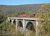 It crossed the Juniata River with MoW equipment on flat cars and some empty cwr carriers.