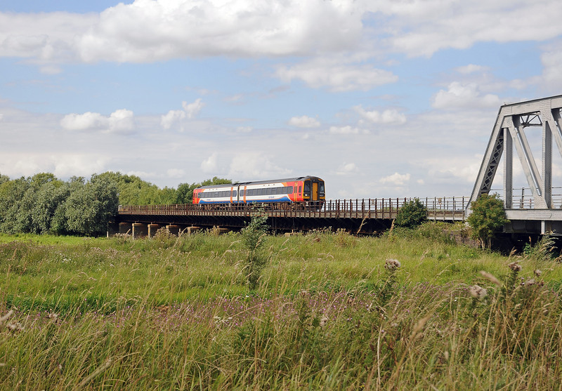 An EMT 158 on a Norwich bound service, crossing the Ouse Washes.