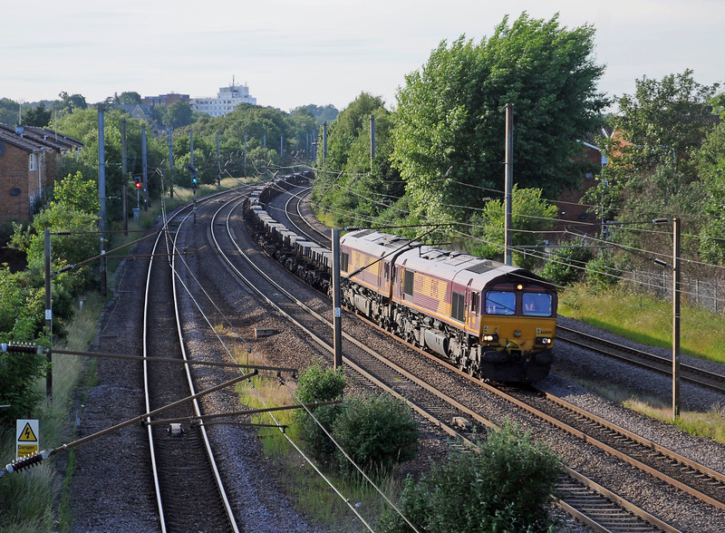 66009 at the head of the 4O26 Scunthorpe to Dollands Moor loaded steel train passing Oakleigh Park some 20 minutes late at 19:03.