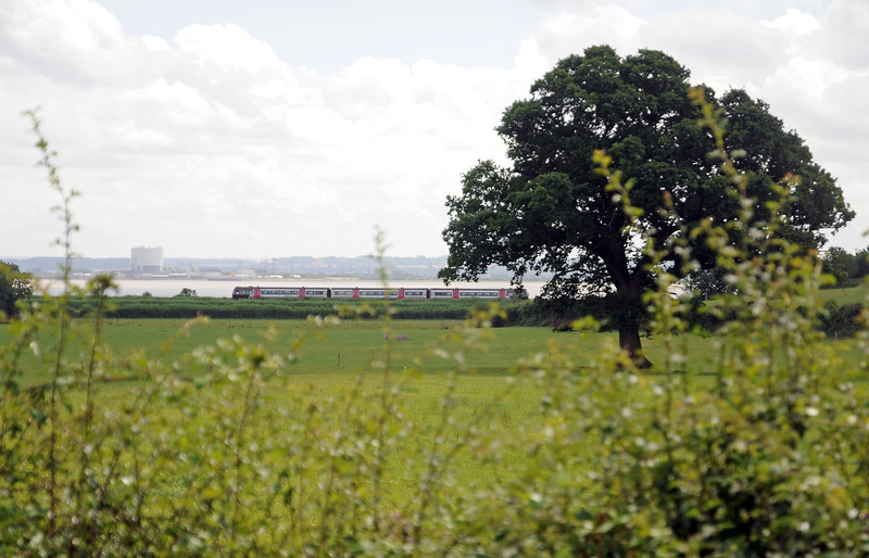 A Cardiff to Derby 170 along the Severn with Oldbury Nuclear Power Station on the east bank.