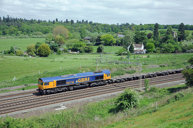 66716 passing Old Linslade church on the 4M23 to Hams Hall, unfortunately all the leading flats were empty, the loads were on the back.