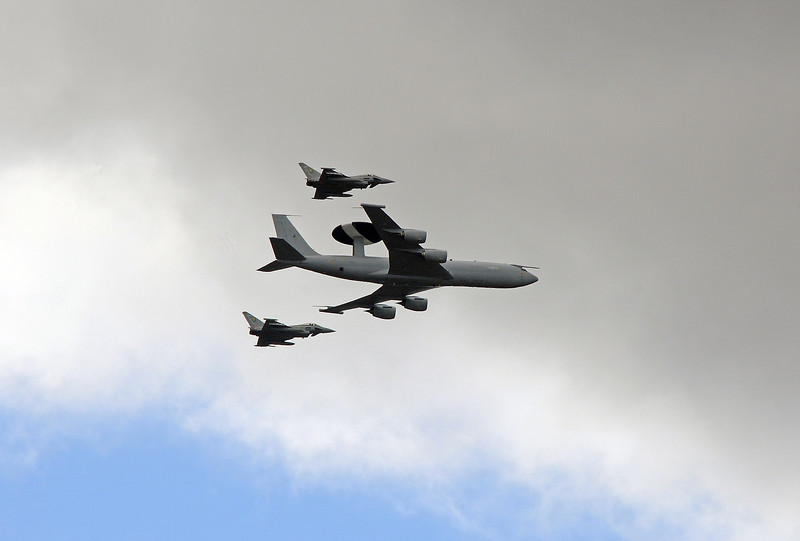 An RAF Boeing E3D AWACS aircraft being escorted over Willesden by a pair of Typhoon Eurofighters, they were part of the fly-past for Trooping the Colour which had just taken place in Central London.