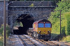 My purpose for being at Hadley Wood was the 4O26 loaded steel train to Dollands Moor and onward to Ebange in Lorraine. It raced through the North Tunnel and was almost parallel with me when the driver appeared to make an emergency brake application, the dust and smoke from the brake blocks completely filled the London bound bore of the South Tunnel, obscuring the daylight at the other end. And from being 10 minutes early at Hadley Wood 4O26 was five minutes late at Alexandra Palace.