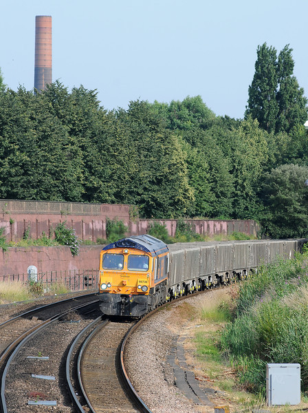 With the smokestack of the former Lots Road generating station peeping above the trees of Brompton Cemetary 66736 Wolverhampton Wanderers on the 6V95 empty spoil train from Northfleet to Westbourne Park.