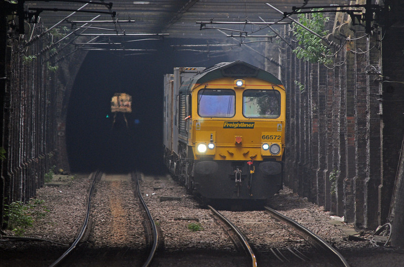 Despite, or maybe because of, the heat in London, cloud did bubble up in the late morning, obscuring the sun just as 66572 on the Felixstowe to Tilbury emerged from Hampstead Tunnel.