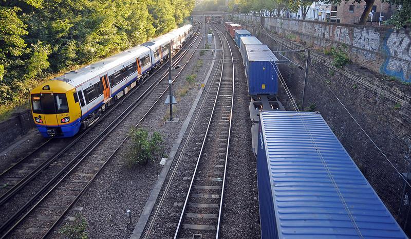 A Highbury & Islington bound 378 passes the last few flats