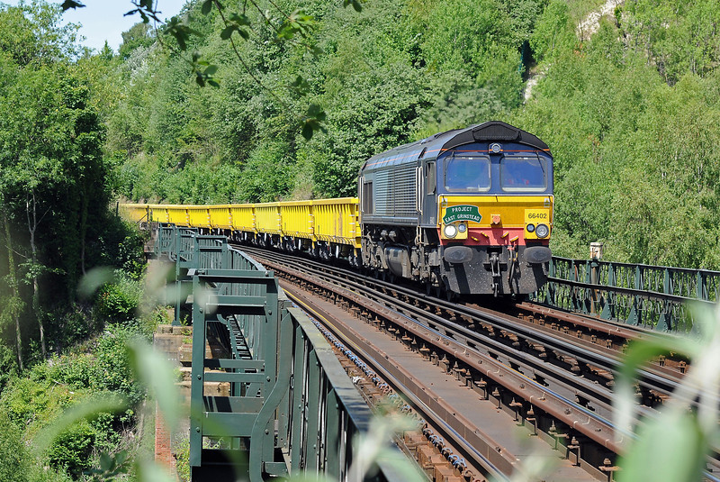 And on July 9th, which was a beautifully sunny day it's 66402 again, this time with the headboard and crossing Riddlesdown Viaduct, one of the impressive iron and steel truss viaducts on the Croydon, Oxted and East Grinstead line. For loco hauled trains there's a 10 mph speed limit.