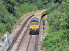 At lunchtime the 6O10 approaches East Grinstead with the empty spoil train from Forders…