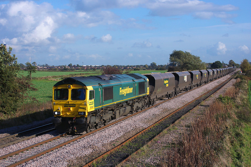 66587 Is seen approaching Sudforth lane in charge of the late running 1235 Drax Aes (Flhh) to Kellingley Colliery (Flhh).25/10/2013.Sony A65.