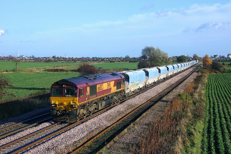 66082 hurries through Whitley Bridge whilst working 6M96 13:18 Drax Power Station to Tunstead Sdgs Aggregates.12/11/2013.Sony A65.