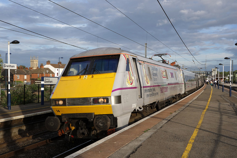 My 91 for the return journey.91114 takes a breather at Grantham whilst in charge of 1D25 17:49 Kings cross- Leeds East coast service.Note No.2 Pantograph in the raised position for the northbound journey.12/08/2013.Sony RX100.