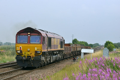Class 66 No 66076 at Hambleton West Junction on 1 August 2014 with the 6N70 12:36 Doncaster Belmont Down Yard – Tyne S.S.