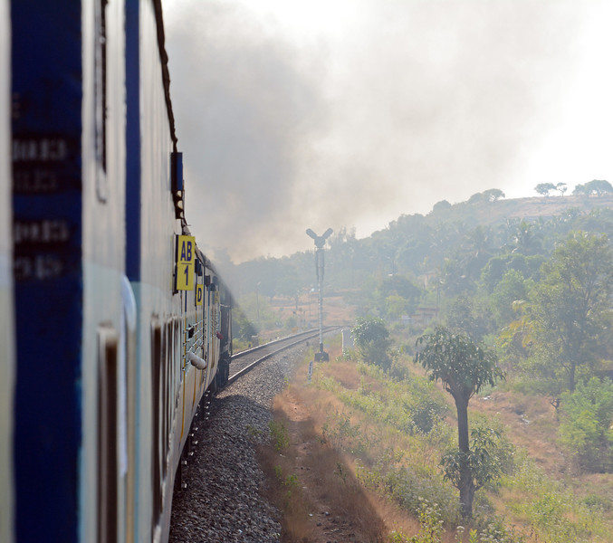 Southbounds have a stiff climb out of Karwar, our WDG3a makes the most of it as it passes the northbound home signal near the top of the short grade.