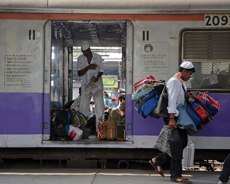 The Dabbawallahs collect thousands of tiffin boxes containing hot lunches from office workers homes or catering services, carry them by train to stations like Marine Lines and then distribute them to individuals at desks in offices across the city centre. Very few mistakes are ever made. And they do the whole thing in reverse after lunch. On the Western Railway the luggage compartment is reserved for the Dabbawallahs.