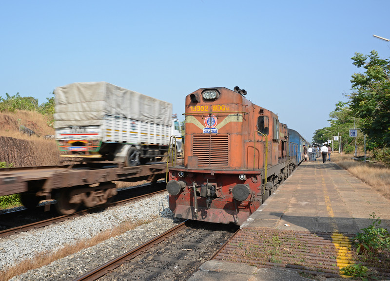 The piggyback train was making at least 50 mph as trucks sped past our waiting WDG3a