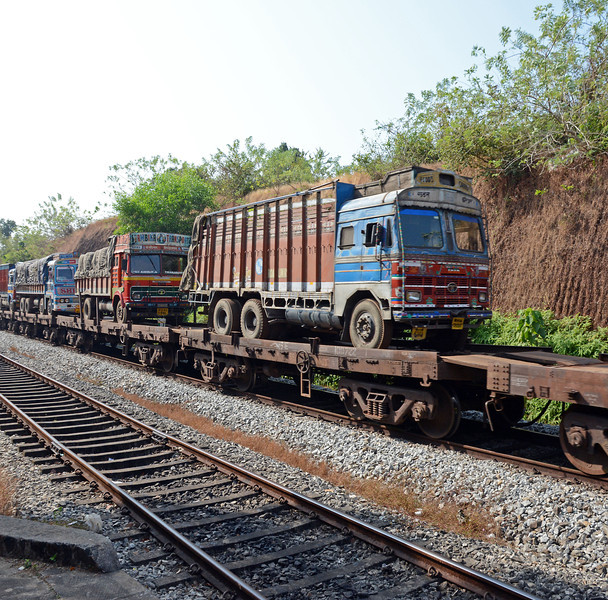 ...and carrying complete trucks, the drivers of which rode in their cabs. Indian Railways use standard short wheelbase flats for ths service.