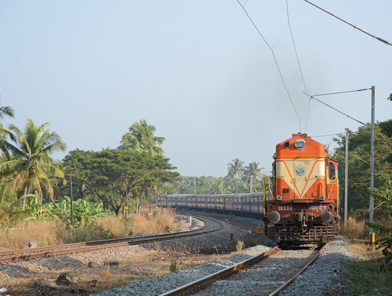 18534 is a WDM2 from Ernakulam shed. It has just left Nileshwar on the Ernad Express from Nagercoil Junction in Tamil Nadu to Mangalore.