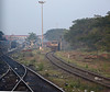 EMD-DLW WDG4 on a train of box cars will either follow us or turn left and head up the Ghats  to Hubli and Guntakal. Despite exhortations to keep things tidy there is a distressing habit of chucking stuff out of trains on to the track, especially noticeable around stations.