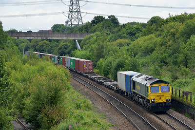 Class 66 No 66587 at Normanton on 5 July 2014 with the 4L85 08:55 Leeds F.L.T. – Doncaster Up Decoy