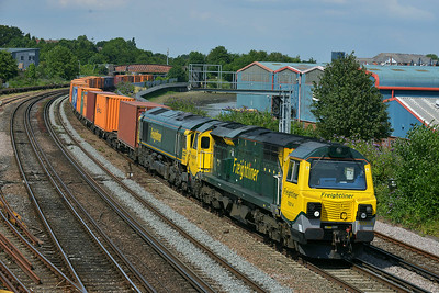 Class 70/66 No 70014/66596 at St Denys on 9 July 2014 with the 4O27 05:40 Garston F.L.T. – Southampton M.C.T.